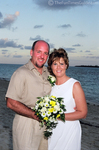 A beachy wedding picture of Jim and Lynnette ...barefoot on the beach in the Bahamas.