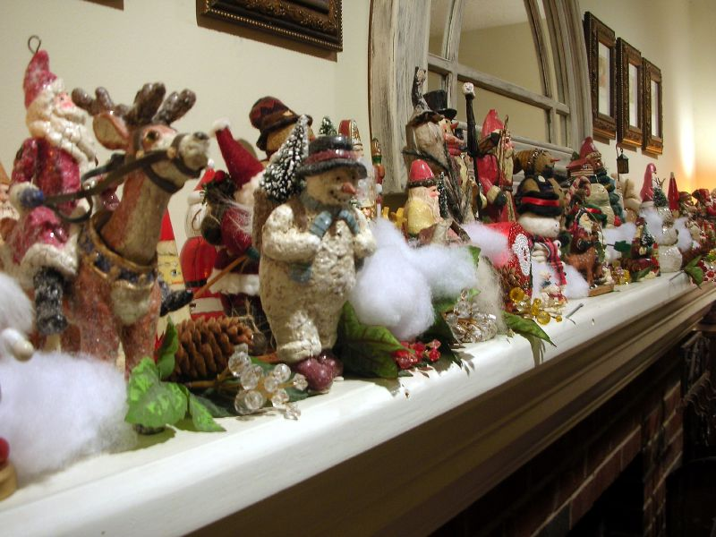 christmas figurines on mantel by john c abell - Beautiful Mantel Christmas Decorations