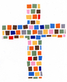 A patchwork cross made from colored paper squares.