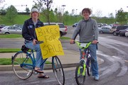 Boys selling their bikes... wearing 'bikes for sale' signs.