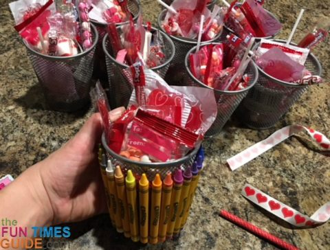 DIY crayon/pencil holder baskets with the Valentine candy inside.