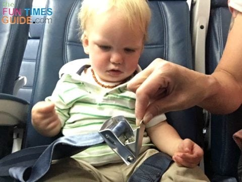 When using a car seat on a plane, you definitely need to consider how your car seat will be secured on the plane -- keeping the airplane lap belt buckle in mind.